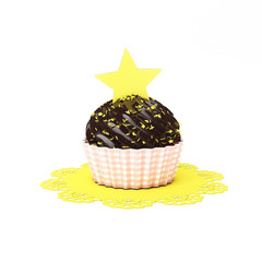 chocolate cupcake with yellow star and doily isolated on white