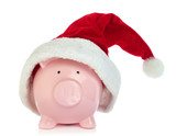 Piggy bank with Santa Claus hat on white background