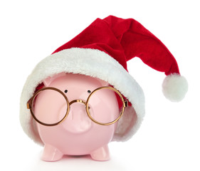 Piggy bank with Santa Claus hat and eyeglasses