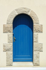 Blue wooden arch door in Cotes-d'Armor, France