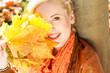 Nice blonde girl in autumn park