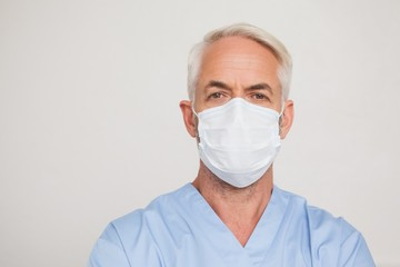 Dentist in surgical mask looking at camera