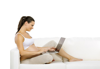Unrecognizable pregnant woman with digital tablet