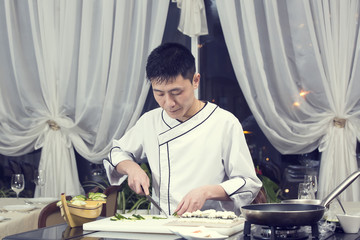Japanese chef preparing a meal in a restaurant