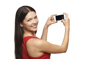 Woman taking pictures through cell phone