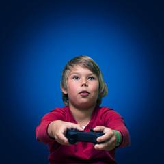 Boy playing computer games.