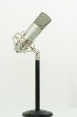 Silver microphone on a black stand