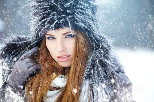 canvas print picture Young woman winter portrait. Shallow dof.