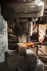 Hard and dirty work at a blacksmith