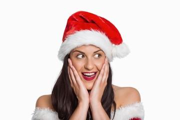 Surprised woman wearing santa hat
