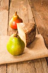 Two pears accompanied by pecorino cheese, Italian delicacy