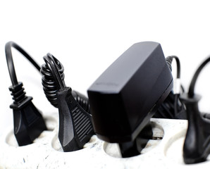 Surge protector and wires on a white background