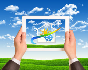 Hands hold tablet pc with weather icon