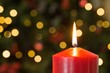 Focus on red christmas candle