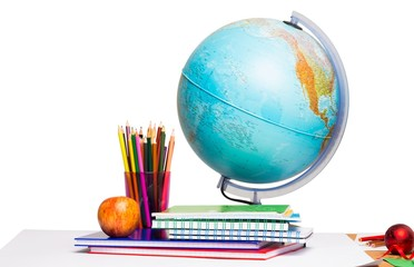 Pupils desk with books and globe