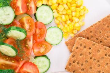 Close up of vegetables and crispy bread.