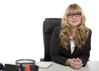 Smiling confident businesswoman in glasses