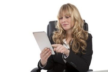 Smiling young businesswoman using her tablet