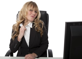 Frustrated businesswoman loosening her collar