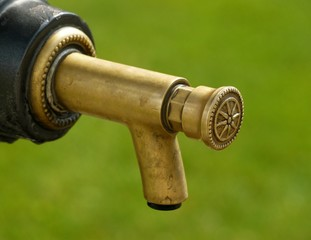 Detail of brass tap on metal drinking fountain