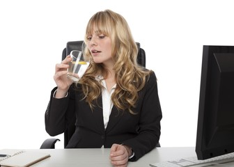 Young businesswoman drinking water and lemon