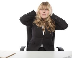 Businesswoman blocking her ears