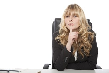 Businesswoman asking for secrecy