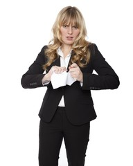 Young businesswoman tearing up a document