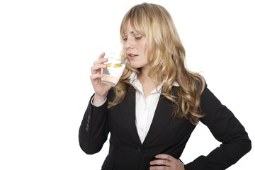 Young professional woman drinking water
