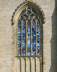 Gothic ornamental window with colored vitrage