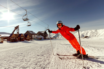 Skier warms up before descent from high winter mountain in Gudau