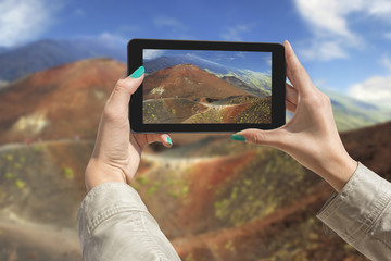 Photographing Etna volcano with tablet