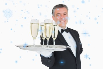 Waiter serving tray full of glasses with champagne