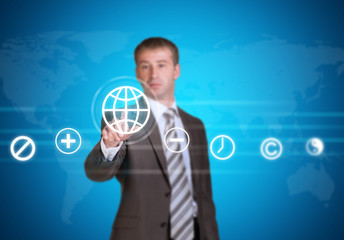 Businessman in suit pointing her finger at cloud icons