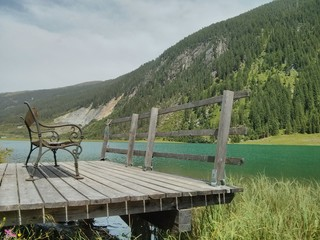 Landing stage on a turquoise mountain lake in the Zillertal