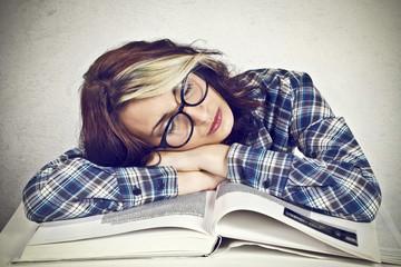 Bored girl reading a book