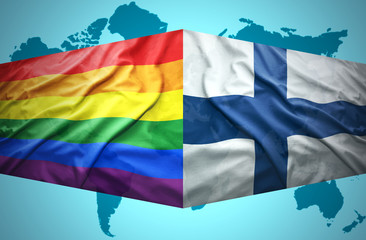 Waving Finnish and Gay flags