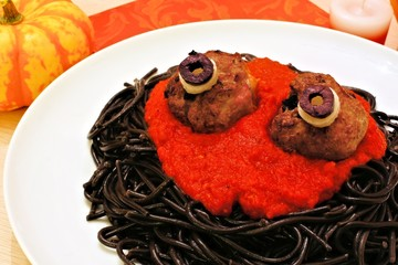 Halloween monster spaghetti with meat eyeballs and decor