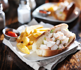 lobster roll with french fries and ketchup