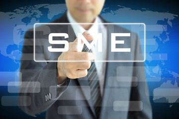 Businessman hand pointing to SME sign on virtual screen