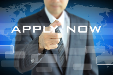 Businessman hand pointing to APPLY NOW on virtual screen