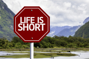Life is Short red sign with a landscape background