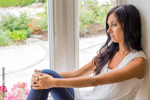 canvas print picture Frau sitzt am Fenster