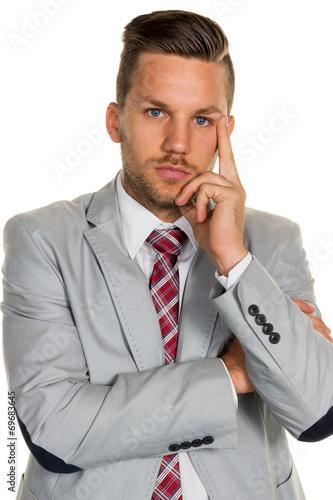 Leinwandbild Motiv Nachdenklicher Manager