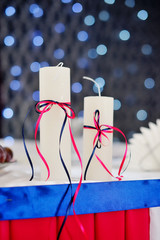 adorned decor with two candles on the background bokeh