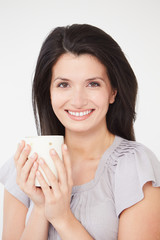 Studio Portrait Of Woman With Hot Drink