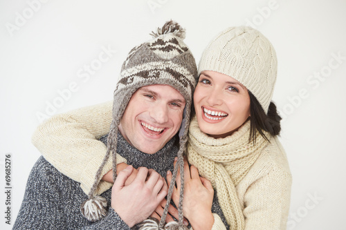 canvas print picture Studio Portrait Of Couple Wearing Warm Winter Clothes