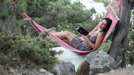 Girl in hammock e-book reading
