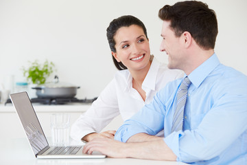 Couple Making Online Purchase At Home
