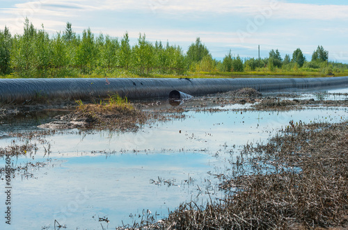 Spilled oil around the oil pipeline - 69685604